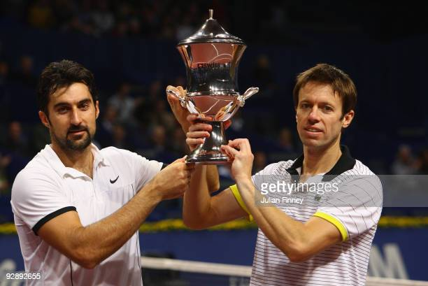 Nenad Zimonjic of Serbia and Daniel Nestor of Canada lift the winners trophy after defeating Mike and Bob Bryan of USA in the doubles final during...