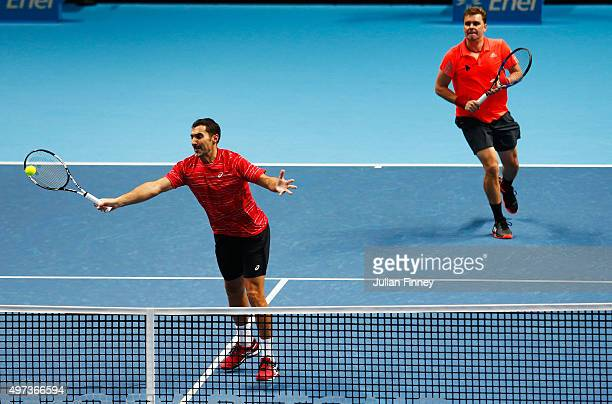 Nenad Zimonjic of Serbia and Marcin Matkowski of Poland in action in their men's doubles match against JeanJulien Rojer of the Netherlands and Horia...