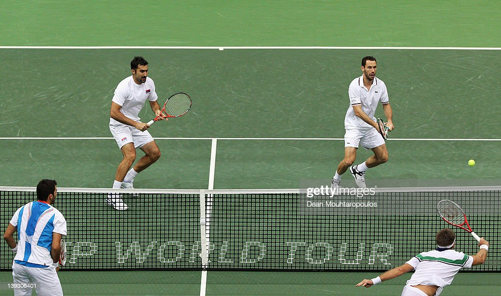 Nenad Zimonjic (L) of Serbia and Michael Llordra of France in action against Robert Lindstedt of Sweden and Horia Tecau of Romania in the Doubles Final on day 7 of the ABN AMRO World Tennis Tournament on February 19, 2012 in Rotterdam, Netherlands.