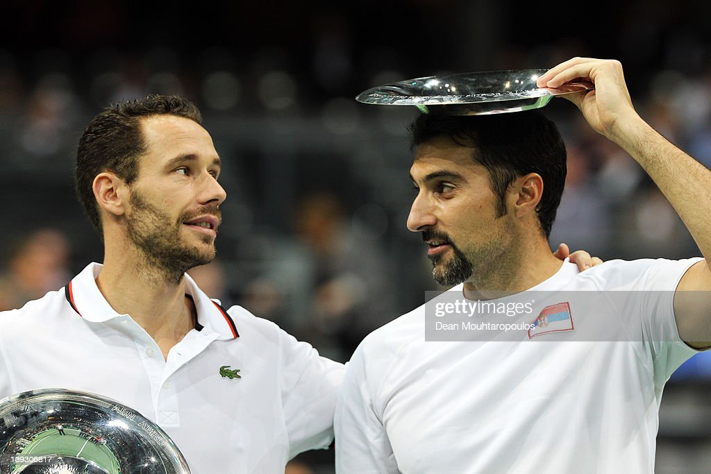 Nenad Zimonjic (R) of Serbia and Michael Llordra of France pose with the Trophy after victory against Robert Lindstedt of Sweden and Horia Tecau of Romania in the Doubles Final on day 7 of the ABN AMRO World Tennis Tournament on February 19, 2012 in Rotterdam, Netherlands.