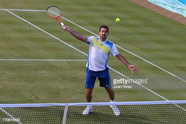 Nenad Zimonjic of Serbia in action during the Men's Doubles semi final round match with Julien Benneteau of France against Alexander Peya of Austria...