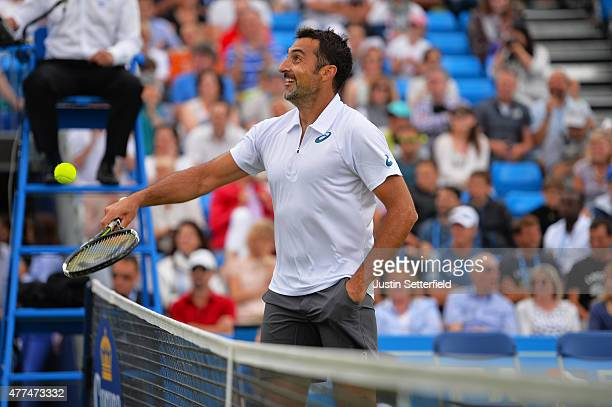 Nenad Zimonjic of Serbia jokes at the net during the Men's doubles match against Grigor Dimitrov of Bulgaria partnering Stan Wawrinka of Switzerland...