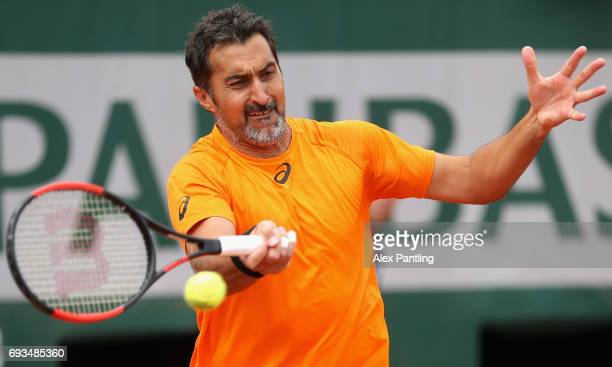 Nenad Zimonjic of Serbia partner of Fernando Verdasco of Spain plays a forehand during mens doubles quarter finals match against Rogerio Dutra Silva...