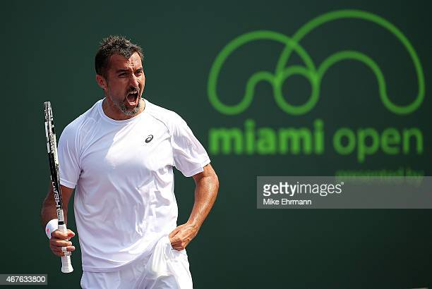 Nenad Zimonjic of Serbia reacts during a doubles match with Marcin Matkowski of Poland against Kevin Anderson of South Africa and Jeremy Chardy of...