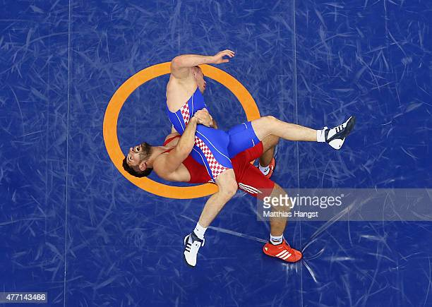 Nenad Zugaj of Croatia and Ramsin Azizsir of Germany compete in the Men's Wrestling 85kg Greco Roman bronze final during day two of the Baku 2015...