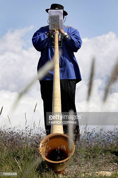 An alphorn player warms up 22 July 2007 prior to playing with an ensemble of more than 100 Alphorn blowers on the final day of the 6th International...