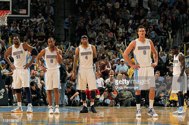 Nene Hilario, Arron Afflalo, Kenyon Martin, Danilo Gallinari and Ty Lawson of the Denver Nuggets look on as they await action against the Oklahoma...