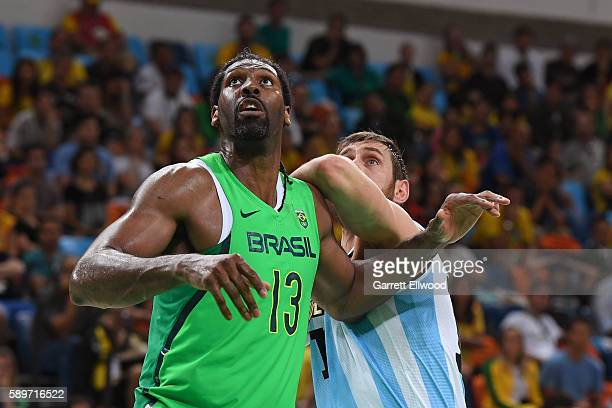 Nene Hilario of Brazil defends against Argentina on Day 8 of the Rio 2016 Olympic Games on August 13 2016 at Barra Carioca Arena 1 in Rio de Janerio...