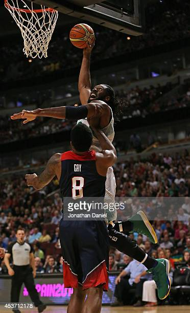 Nene Hilario of team Brazil goes up for a shot over Rudy Gay of team USA during an exhibition game at the United Center on August 16 2014 in Chicago...