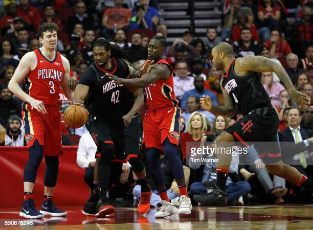 Nene Hilario of the Houston Rockets battles with Jrue Holiday of the New Orleans Pelicans for a loose ball in the second half at Toyota Center on...