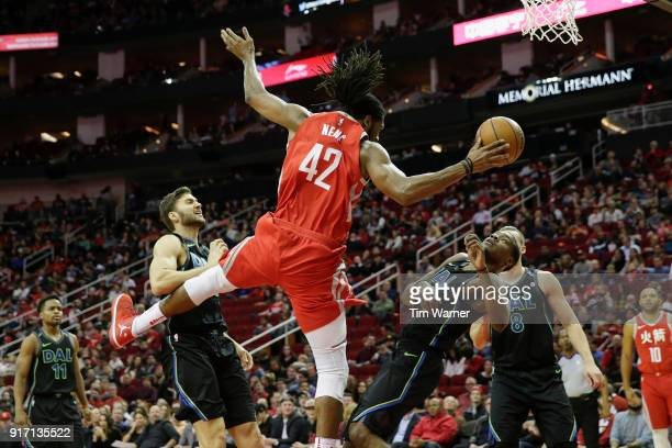 Nene Hilario of the Houston Rockets collides with Jalen Jones of the Dallas Mavericks on the way to the basket in the first half at Toyota Center on...
