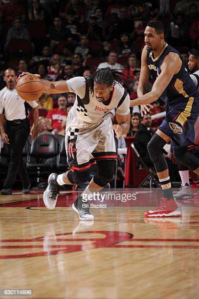 Nene Hilario of the Houston Rockets drives to the basket against Alexis Ajinca of the New Orleans Pelicans during the game on December 16 2016 at the...