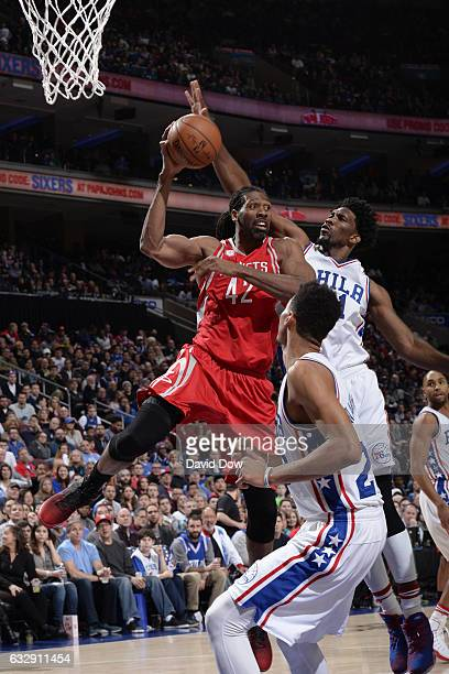 Nene Hilario of the Houston Rockets drives to the basket and passes the ball against the Philadelphia 76ers at Wells Fargo Center on January 27 2017...