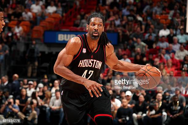 Nene Hilario of the Houston Rockets handles the ball during the game against the Miami Heat on January 17 2017 at AmericanAirlines Arena in Miami...