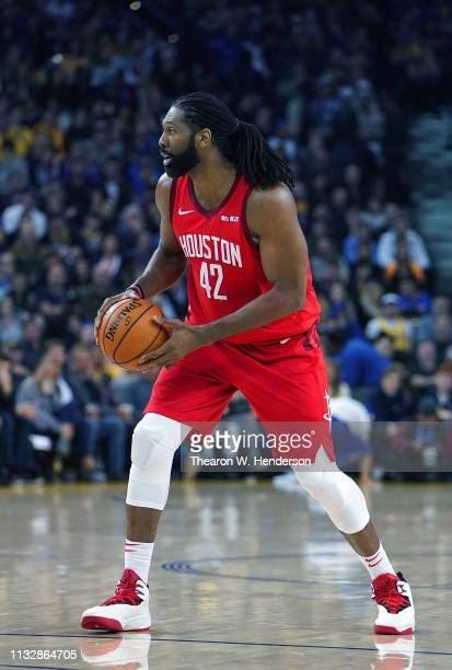 Nene Hilario of the Houston Rockets looks to pass the ball against the Golden State Warriors during an NBA basketball game at ORACLE Arena on...