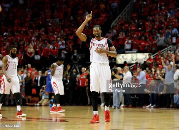 Nene Hilario of the Houston Rockets points skyward after Game Two of the Western Conference quarterfinals game against the Oklahoma City Thunder...