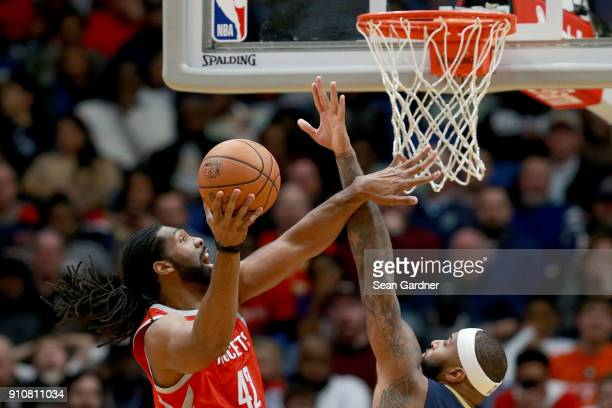 Nene Hilario of the Houston Rockets shoots over DeMarcus Cousins of the New Orleans Pelicans during the first half at the Smoothie King Center on...