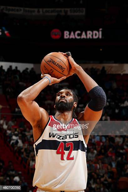 Nene Hilario of the Washington Wizards attempts a free throw against the Miami Heat on December 19 2014 at American Airlines Arena in Miami Florida...