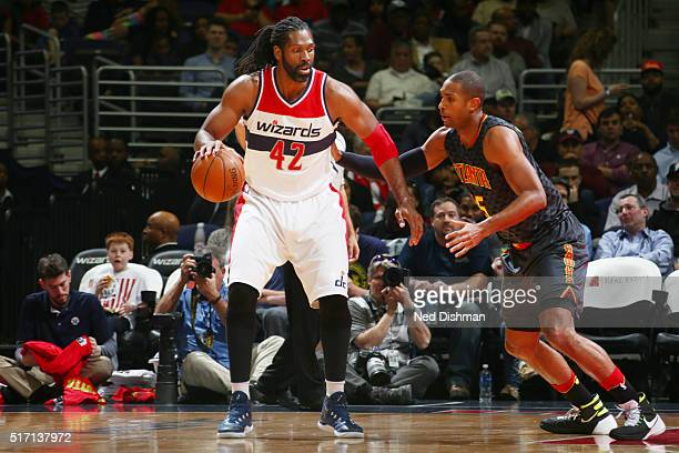 Nene Hilario of the Washington Wizards defends the ball against the Atlanta Hawks during the game on March 23 2016 at ATT Center in San Antonio Texas...