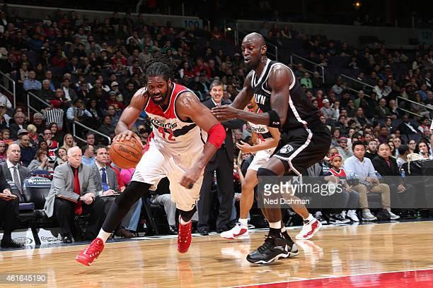 Nene Hilario of the Washington Wizards drives against Kevin Garnett of the Brooklyn Nets on January 16 2015 at Verizon Center in Washington DC NOTE...