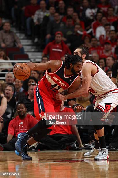 Nene Hilario of the Washington Wizards drives against the Chicago Bulls in Game 5 of the Eastern Conference Quarterfinals in the 2014 NBA Playoffs on...