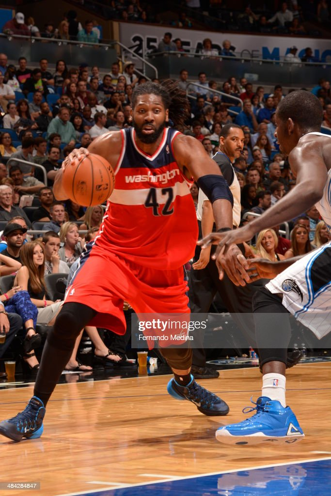 Nene Hilario #42 of the Washington Wizards drives baseline against the Orlando Magic during the game on April 11, 2014 at Amway Center in Orlando, Florida.