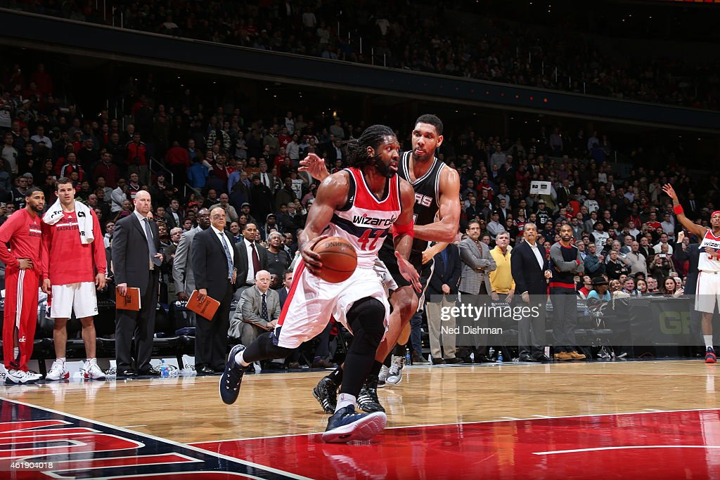 Nene Hilario #42 of the Washington Wizards drives to the basket against Tim Duncan #21 of the San Antonio Spurs on January 13, 2015 at Verizon Center in Washington, DC.