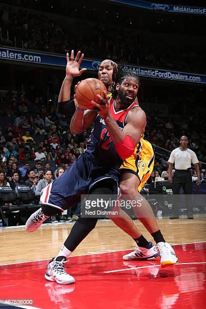 WASHINGTON DC MARCH 25 Nene Hilario of the Washington Wizards drives to the basket against the Indiana Pacers against the Indiana Pacers on March 25...