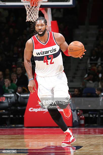 Nene Hilario of the Washington Wizards drives up the court against the Boston Celticsduring the game on December 27 2014 at Verizon Center in...