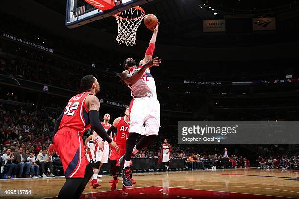 Nene Hilario of the Washington Wizards goes for the layup against the Atlanta Hawks during the game on April 12 2015 at Verizon Center in Washington...