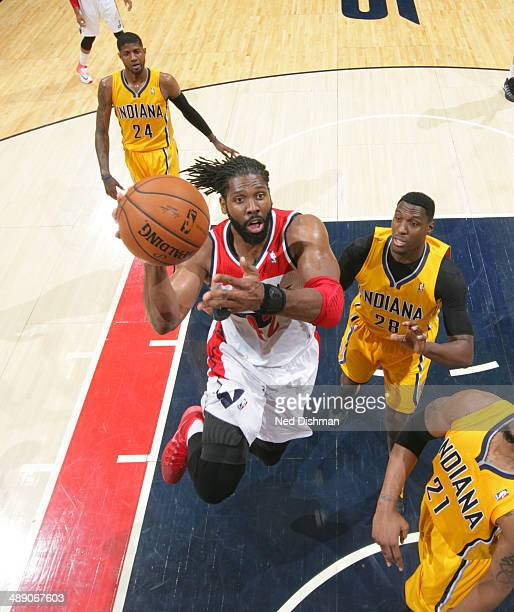 Nene Hilario of the Washington Wizards goes up for the layup against the Indiana Pacers in Game Three of the Eastern Conference SemiFinals during the...