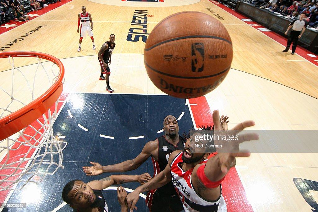 Nene Hilario #42 of the Washington Wizards grabs a rebound against the Miami Heat at the Verizon Center on April 10, 2013 in Washington, DC.