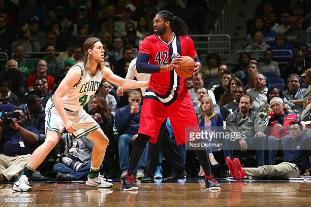 Nene Hilario of the Washington Wizards handles the ball during the game against the Boston Celtics on January 16 2016 at Verizon Center in Washington...