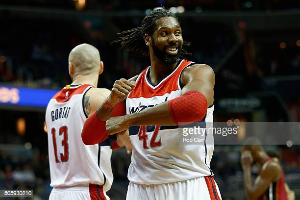 Nene Hilario of the Washington Wizards looks for a traveling call against the Miami Heat in the first half at Verizon Center on January 20 2016 in...