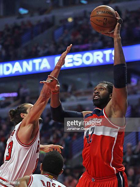 Nene Hilario of the Washington Wizards puts up a shot over Joakim Noah of the Chicago Bulls at the United Center on January 11 2016 in Chicago...