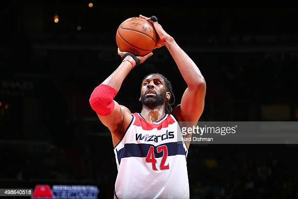 Nene Hilario of the Washington Wizards shoots a free throw during the game against the Indiana Pacers on November 24 2015 at Verizon Center in...