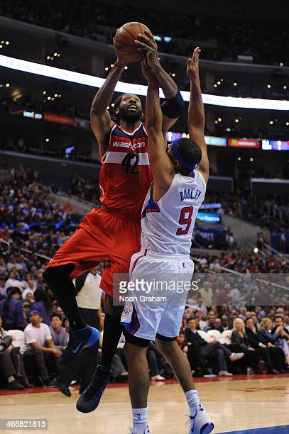 Nene Hilario of the Washington Wizards shoots against Jared Dudley of the Los Angeles Clippers at STAPLES Center on January 29 2014 in Los Angeles...