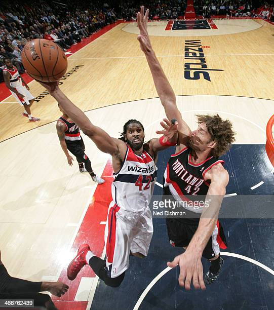 Nene Hilario of the Washington Wizards shoots against Robin Lopez of the Portland Trail Blazers during the game at the Verizon Center on February 3...
