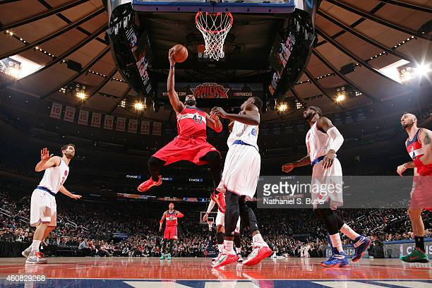 Nene Hilario of the Washington Wizards shoots during a game against the New York Knicks at Madison Square Garden on December 25 2014 in New York New...