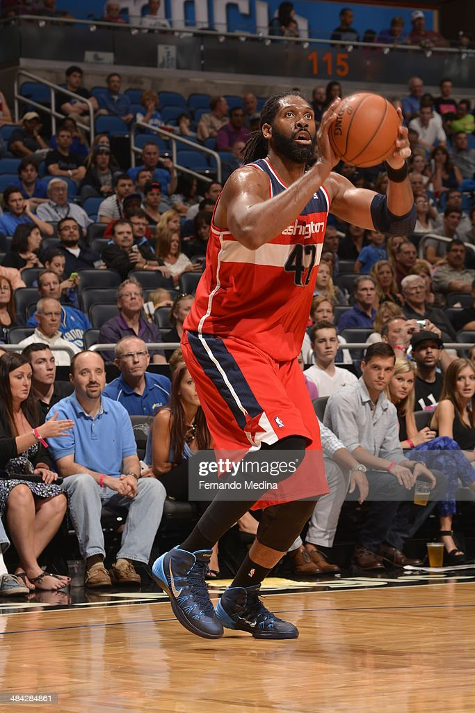 Nene Hilario #42 of the Washington Wizards shoots the ball against the Orlando Magic during the game on April 11, 2014 at Amway Center in Orlando, Florida.