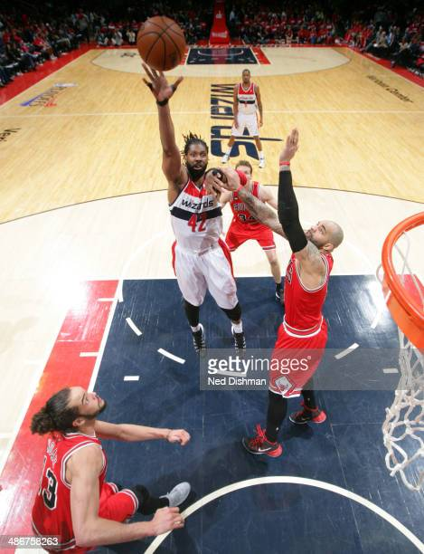 Nene Hilario of the Washington Wizards shoots the ball against the Chicago Bulls in Game Three of the Eastern Conference Quarterfinals during the...