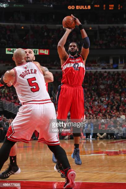 Nene Hilario of the Washington Wizards shoots the ball in Game 2 of the Eastern Conference Quarterfinals against the Chicago Bulls on April 22 2014...