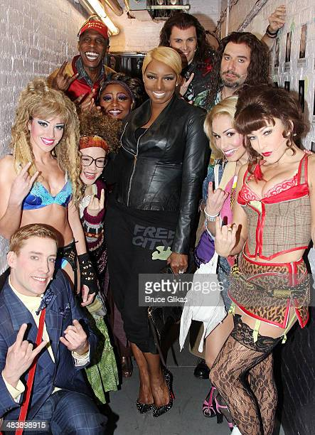 NeNe Leakes poses backstage with the cast of Rock Of Ages on Broadway at The Helen Hayes Theater April 10 2014 in New York City