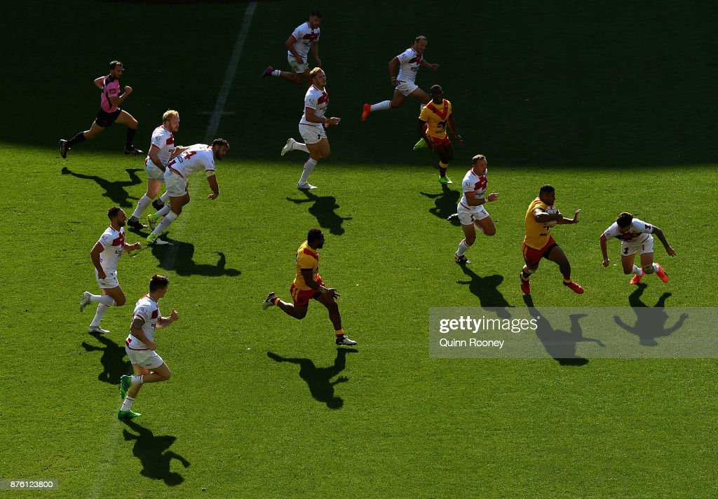 Nene MacDonald of Papua New Guinea breaks through the English defence during the 2017 Rugby League World Cup Quarter Final match between England and Papua New Guinea Kumuls at AAMI Park on November 19, 2017 in Melbourne, Australia.