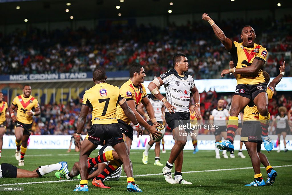 Nene Macdonald of Papua New Guinea celebrates with team mates after scoring a try during the International Rugby League Test match between Fiji and Papua New Guinea at Pirtek Stadium on May 7, 2016 in Sydney, Australia.