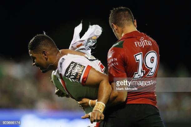 Nene MacDonald of the Dragons is tackled by Braidon Burns of the Rabbitohs during the NRL trial match between the South Sydney Rabbitohs and the St...