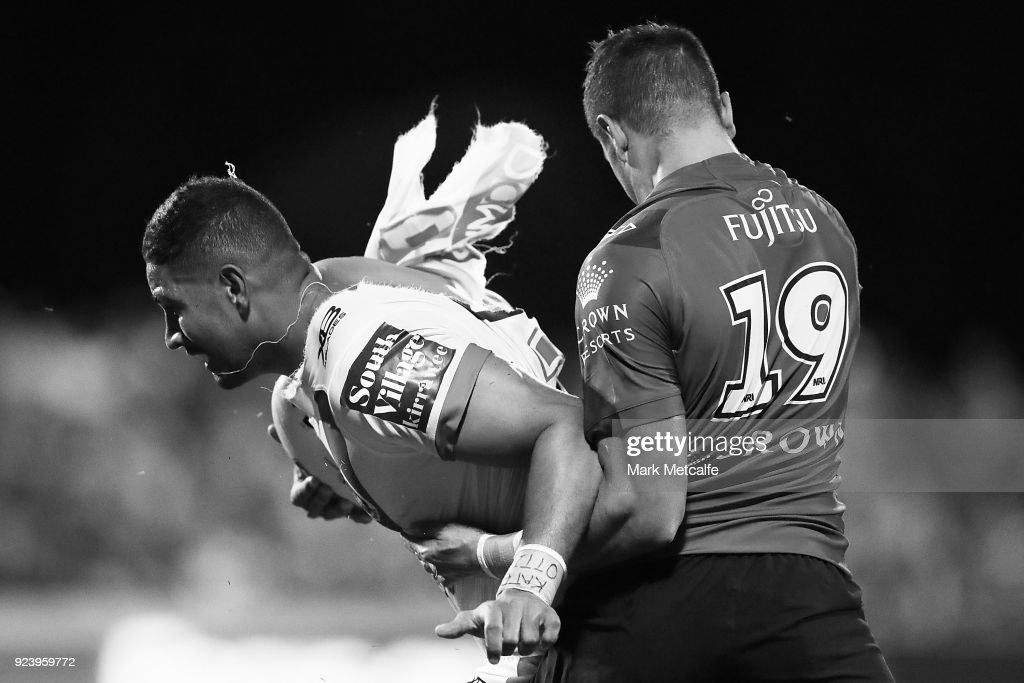 Nene MacDonald of the Dragons is tackled by Braidon Burns of the Rabbitohs during the NRL trial match between the South Sydney Rabbitohs and the St George Illawarra Dragons at Glen Willow Regional Sports Stadium on February 24, 2018 in Mudgee, Australia.