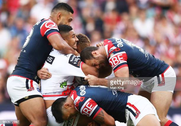 Nene Macdonald of the Dragons is tackled during the round eight NRL match between the St George Illawara Dragons and Sydney Roosters at Allianz...