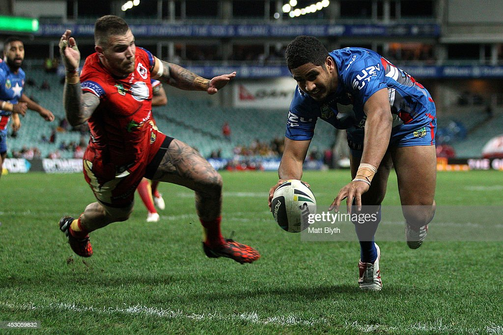 Nene Macdonald of the Roosters scores a try during the round 21 NRL match between the Sydney Roosters and the St George Illawarra Dragons at Allianz Stadium on August 2, 2014 in Sydney, Australia.