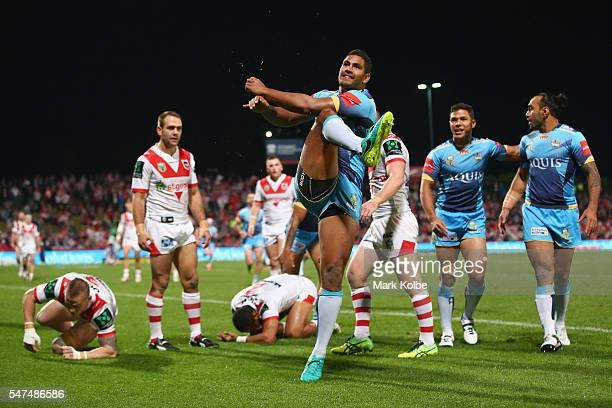 Nene Macdonald Of the Titans celebrates scoring a try during the round 19 NRL match between the St George Illawarra Dragons and the Gold Coast Titans...